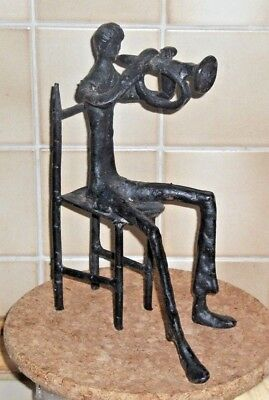 Giacometti  Style Sculpture In Cast Metal,  Man Playing Trumpet On A Chair