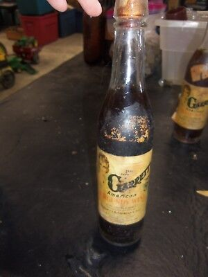 Very Old Embossed Garrett's Burgundy Wine Bottle with Paper Label