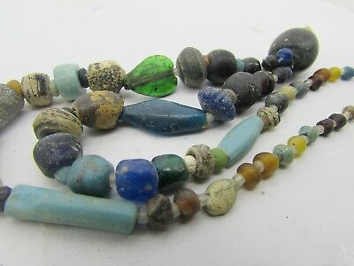 Ancient 50 Roman Glass rare beads of string in multi-colors from Afghanistan.