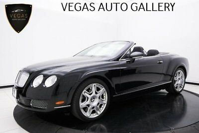 2009 Bentley Continental GTC  Piano & Turned Aluminum Dash, Bentley Door Sills, Black Leather with Red Piping