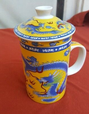 Ornate ceramic Chinese covered cup with ceramic strainer insert