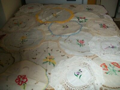 50 vintage embroidered doilies. vgc