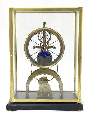 Great Wheel Skeleton Clock with chain fusee and multiple dials in glass case