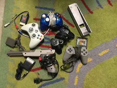 vintage gaming  gamers grab  lot of controls and parts and game related items