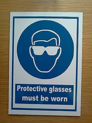 Protective Glasses Must Be Worn (Top Quality Rigid Sign) Safety Sign
