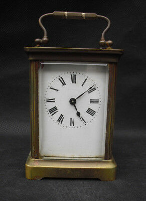 Antique carriage clock with enamel face and brass and glass case not running (2)
