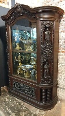 18th century Highly carved French Gothic Oak cabinet w/Santos & Angels Figures