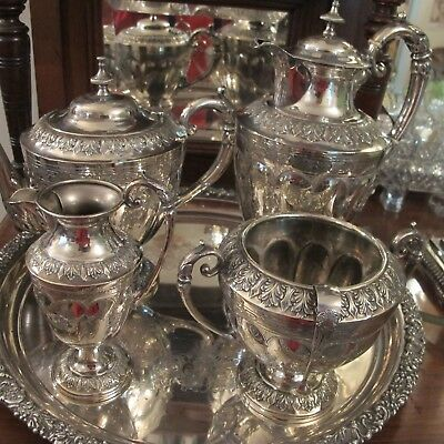 Antique Silver Plate Tea And Coffee Service.