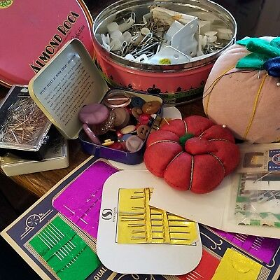 1944 Almond Roca tin w/sewing accessories, notions, pin cushions, buttons, etc