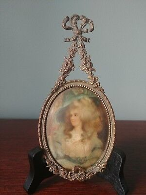 Ornate Brass Miniature Frame With Ribbon Embellishment and Portrait of Women