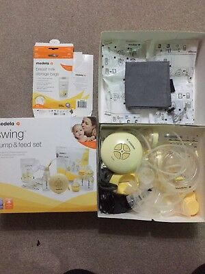 Medela Single Swing Electric Breast Pump with extra milk storage bags