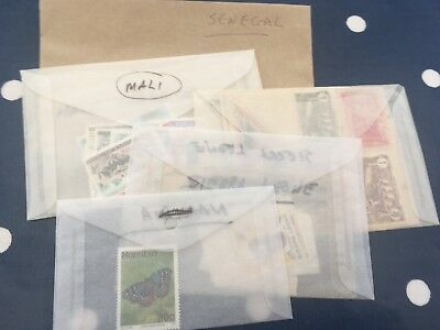 Africa Congo Mali etc off paper stamps direct from estates in bags unchecked