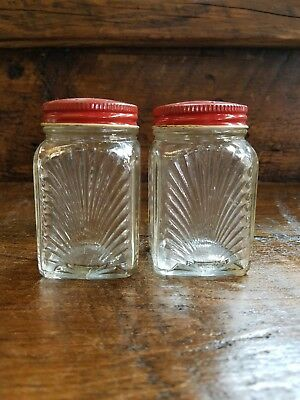 Vintage salt and pepper shakers Glass with Red Metal Lid