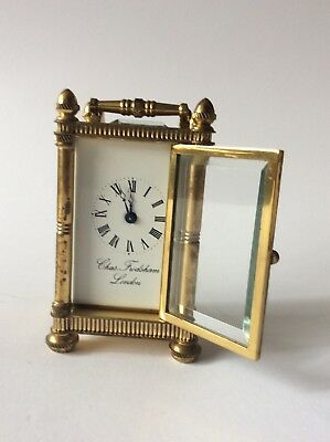 Charles Frodsham brass carriage clock of oval form 12cm high