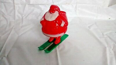 Vintage Rosboro plastic Santa on skis candy container