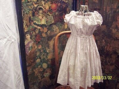 A childs, antique, victorian dress. Lovely whitework.