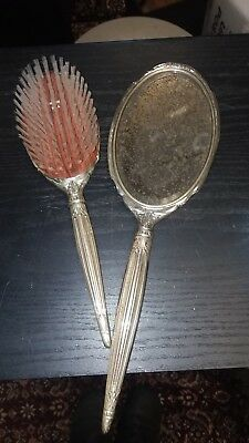 ANTIQUE DECORATIVE STERLING SILVER HAND HELD MIRROR  and matching brush set!!