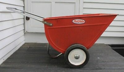 Vintage metal wheelbarrow in excellent condition. Large, red, with metal handle.