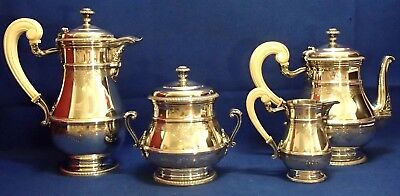 OUTSTANDING SET for TEA  (4 pieces) in Sterling Silver + handles in sort of Bone