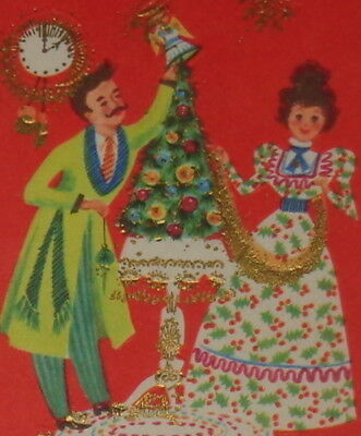 vintage christmas cardcute couple decorating the tree