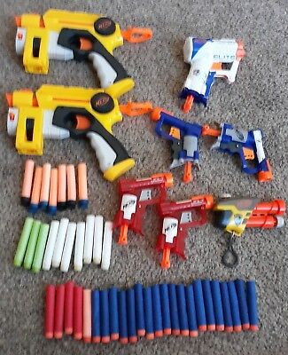 Lot of 7 Nerf Guns with nerf Dart bullets  Gently used, bonus nerf keychain