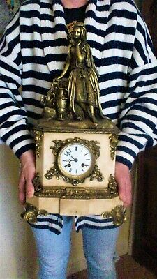 A Large French White Marble And Bronze Figural Mantel Clock.