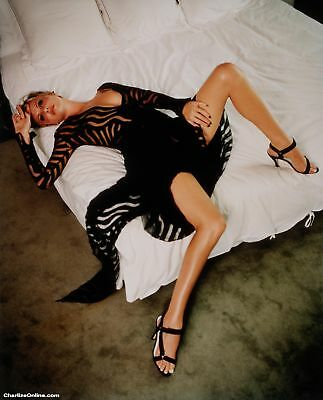 Charlize Theron Posing In Bed With Black Suit 8x10 Picture Celebrity Print