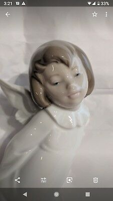 LLADRÓ CHERUB SMILING  01004960 / Curious Angel , Retired. New in Box.