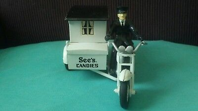 sees candies dye cast motorcycle and cart eith rider figurine