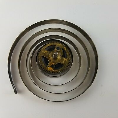 """Vintage Clock Mainspring Coil with Gear 3/8"""" wide"""