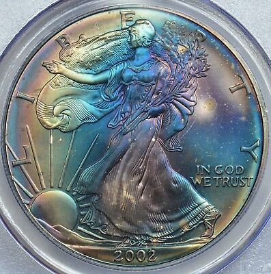 PCGS 2002 MS67 attractive mint case toned Silver Eagle. toning