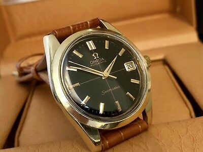 Omega Seamaster 1960s vintage black dial automatic Cal 562 mens gold watch + box