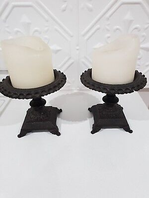 Two cast iron vintage antique candle holder