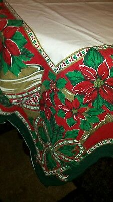 White Christmas tablecloth with lots of red and green