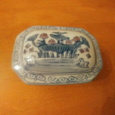 Pottery trinket box with chinese design
