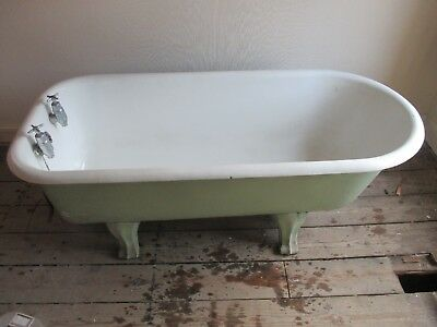 Early 20th cast iron roll top bath with bottle taps