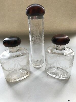 3 Silver And Faux Tortoiseshell Topped  Glass  Bottles