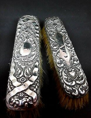 Pair of antique solid silver hallmarked backed brushes