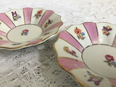 A pretty pair of pink and floral vintage china  pin trays