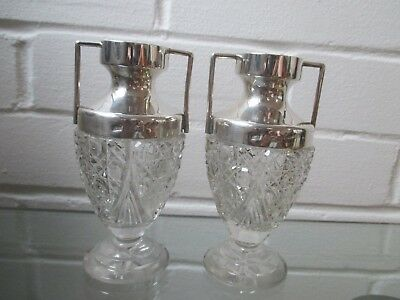 A pair of antique marked silver necked urn shaped bud vases with cut glass body