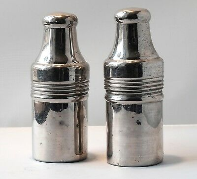 Two apothecary jars in Chrome travel cases