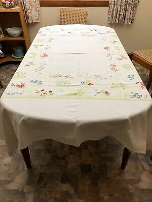 VINTAGE TABLECLOTH with GREEN WOODS DESIGN and RED YELLOW BLUE FLOWERS 75 x 60