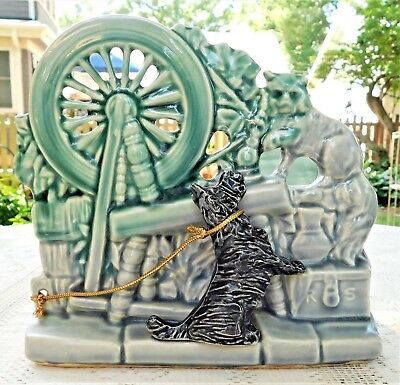 VINTAGE MID-20th CENTURY MCCOY POTTERY SPINNING WHEEL W/ DOG & CAT PLANTER