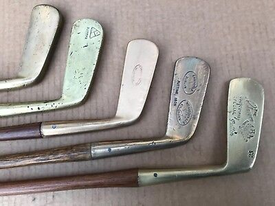 5 Hickory Shafted Brass & Gun Metal Headed Putters In Good Overall Condition.