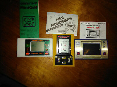 Nintendo and Grandstand Hand held games with instructions