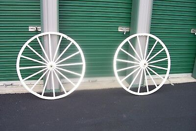 "PAIR OF VERY RUSTIC 40"" LARGE WAGON WHEELS. (wood spokes, iron outer rim)"