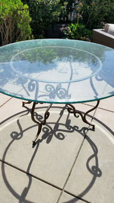 Vintage round wrought iron table with beveled glass top