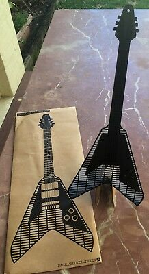 Guitar shaped Flyswatter by Page thirty three