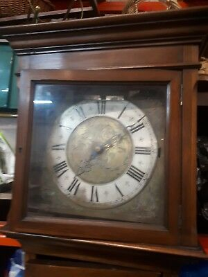 Antique Mahogany Grandfather Clock With A Brass Face