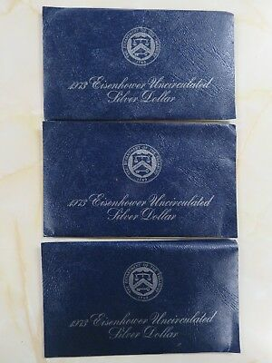 3 pieces of the 1973s silver Eisenhower Ike Dollars in Blue Packs BU
